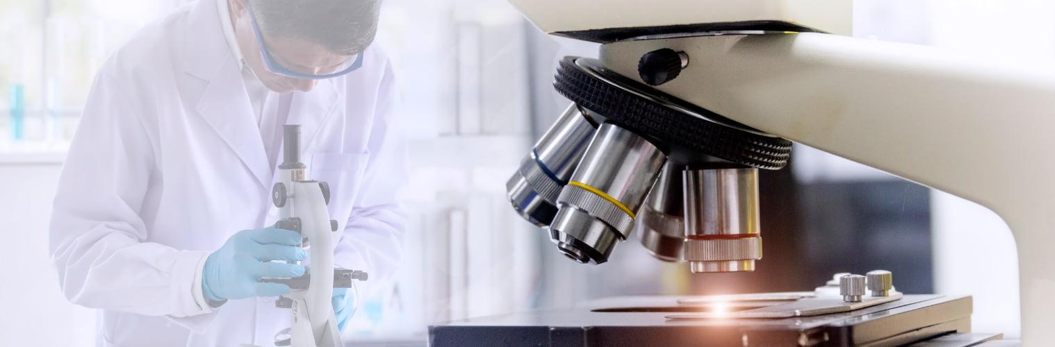 Microbiologist With Microscope - Vishwaraj Hospital